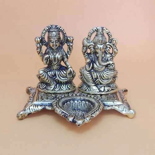 White Metal Ganesh & Lakshmi With Diya - USA Delivery Only